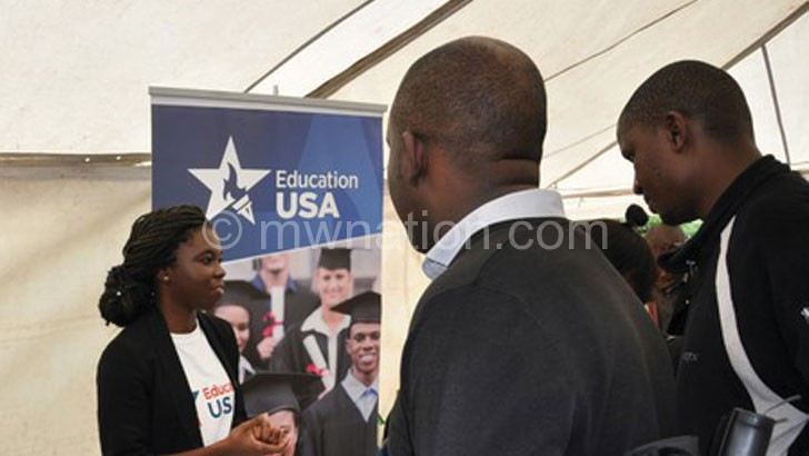 Flashback: Chitawo (L) interacting with Education Fair attendees at an earlier event