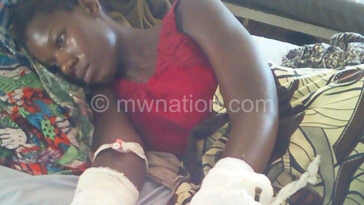 In pain Nelia Kamtayeni on her hospital bed