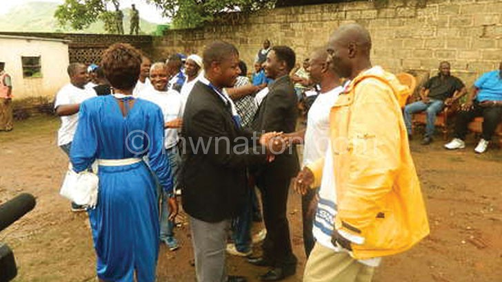 Kaliyapa (in black jacket) being congratulated after being elected supporters committee chairperson
