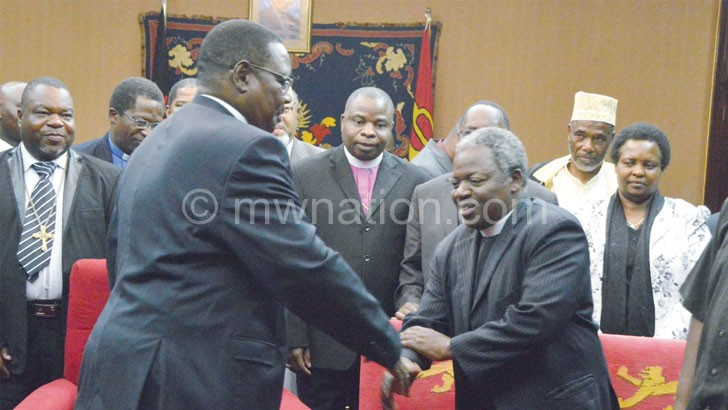 Flashback: Mutharika shakes hands with PAC chairperson the Very Reverend Felix Chingota at previous  meeting
