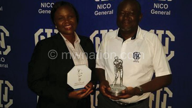 Champions: Hara (R) and Mbilizi show off their trophies