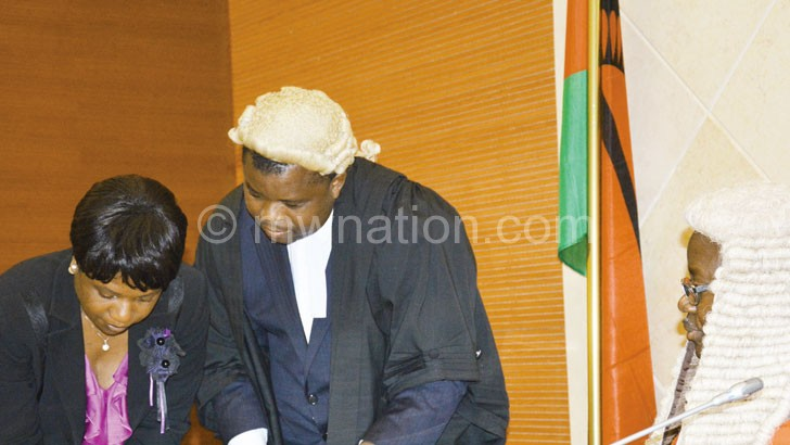 To give an explanation: Kalemba (L)pictured as she took her oath of office