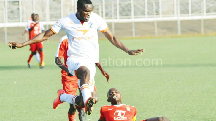 Wadabwa (L) beats Lions' Chikoti Chirwa before scoring the third goal for Wanderers