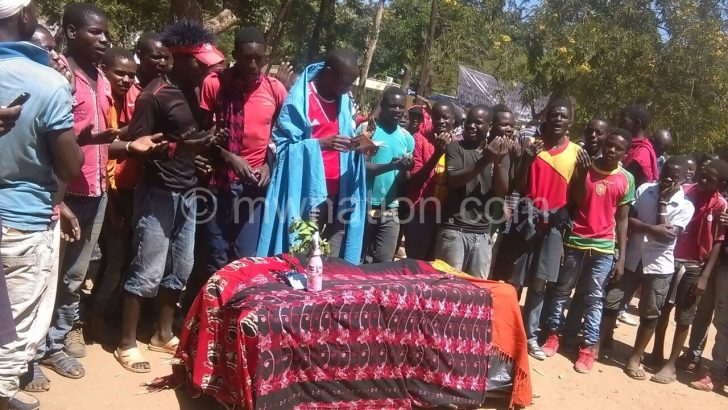 Some of Bibi Kuluunda's subjects stage a protest with a mock funeral service at the DC's office