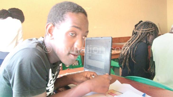 Mhango in class at MIJ Mzuzu campus