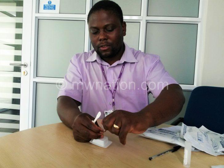 Kumwenda demonstrates how the device works