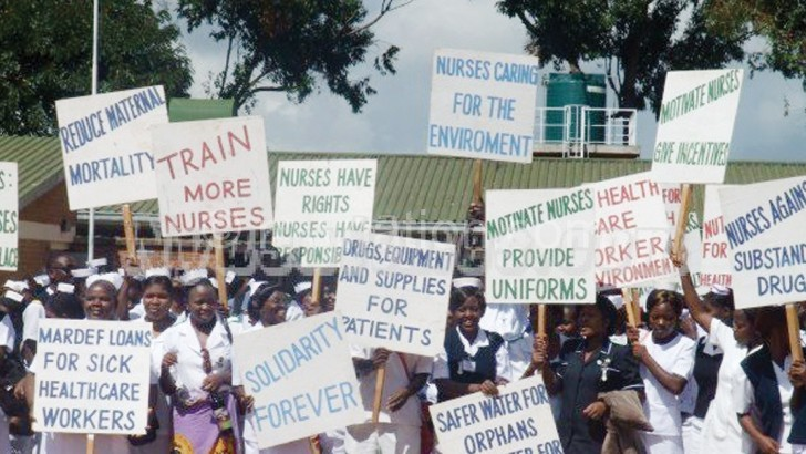 Nurse seen on strike in this file photograph