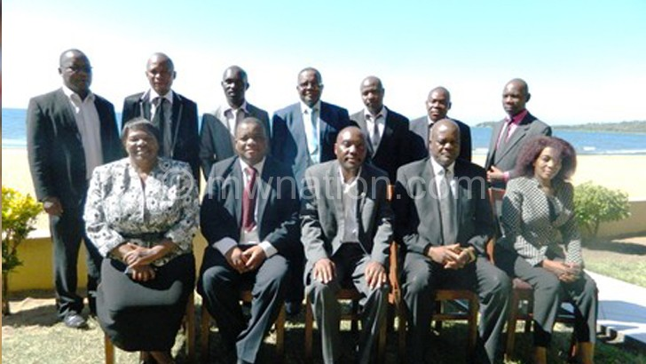 Sembereka (seated C) poses with Kachama (seated 2nd R), commissioners of police and other police officers