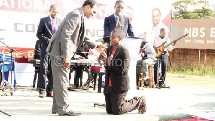 Apostle Ziba (L) interacts with one of the awardees