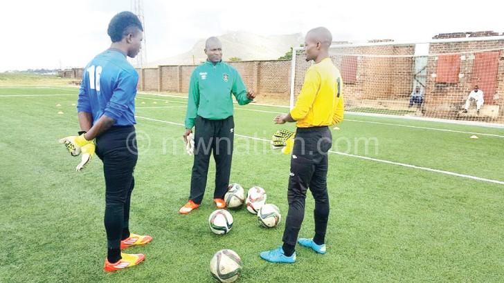 (R) with goalkeeper trainer  Swadick Sanudi during training