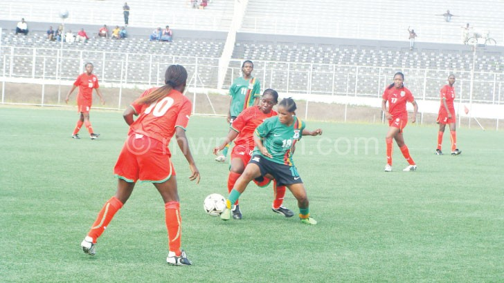 Malawi (in red) in action against Zambia