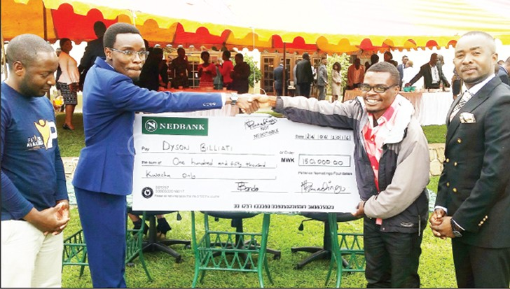 Namadingo (2nd L) presents a dummy cheque to Billiat (2nd R)