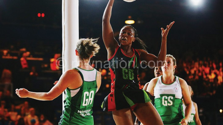 Airtel brand ambassador Queens' Mwawi Kumwenda (L) in action at the  Netball World Cup