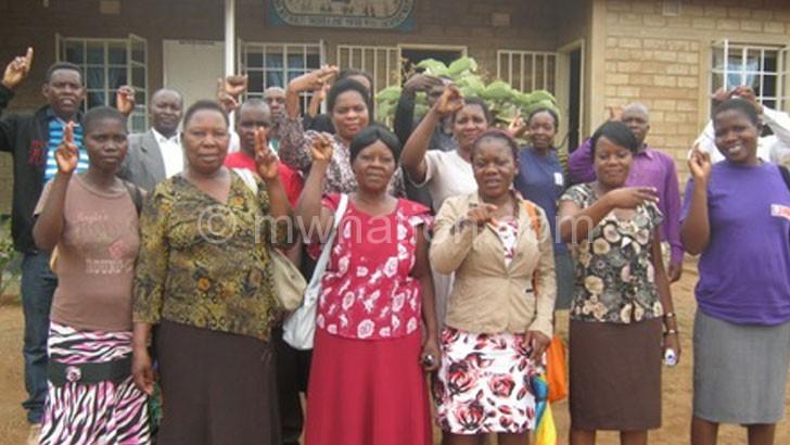 Participants practising sign language