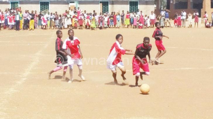 Girls football action between Mpasa (in black) and Nazombe