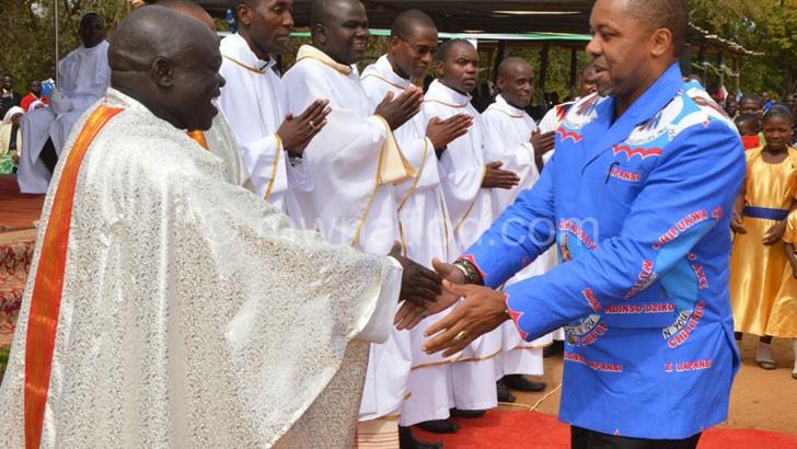 Chilima (R) greets Fr. Protazio Mantchichi