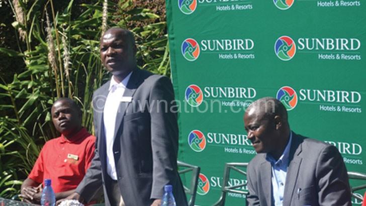 Ku Chawe GM Silvester Mtambo (C) and Godfrey Phiri (R) during a press briefing