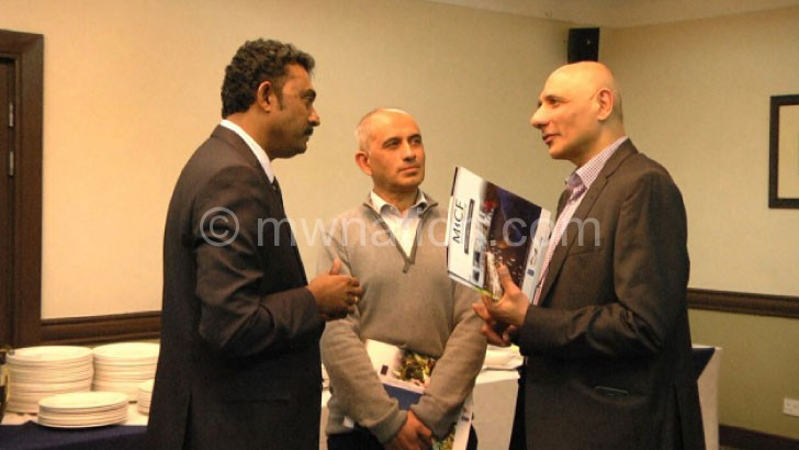Micf fund manager Navin Kumar (L) interacts with some of the participants at the launch yesterday