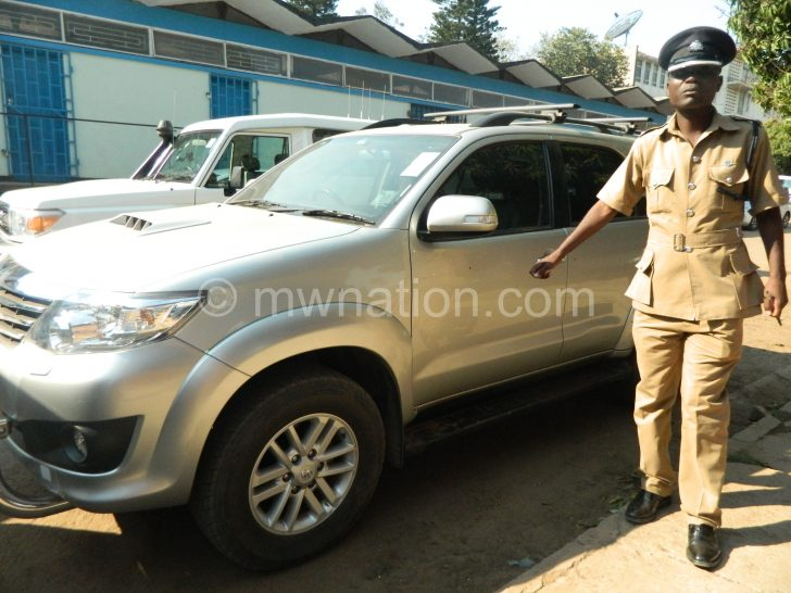 Kadadzera points as some bullets (encircled) holed into the recovered car during the shoot-out
