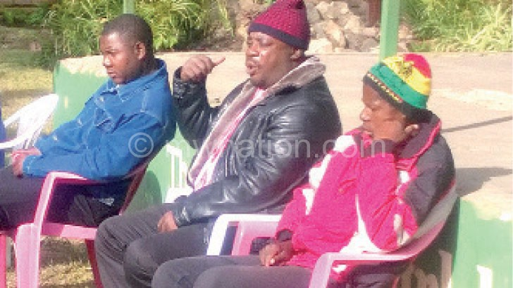 Mwamadi (C) flanked by secretary Manze Chikoti (L) and treasurer Dave Matemba during yesterday's meeting