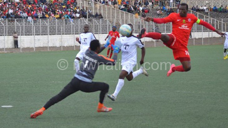 Brace hero: Msowoya (R) flicks the ball over Makina to score his second goal