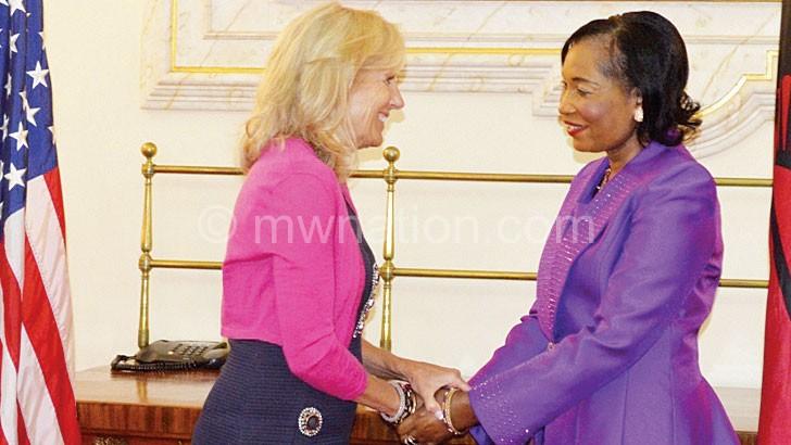 Mutharika (R) greets Biden yesterday