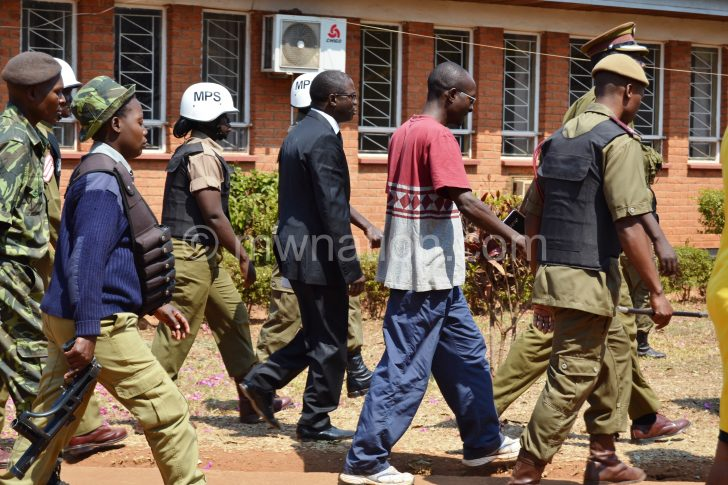 Kasambara (C) arrives at the court yesterday