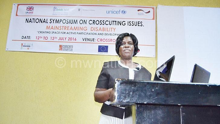 Mweso making her presentation at the symposium