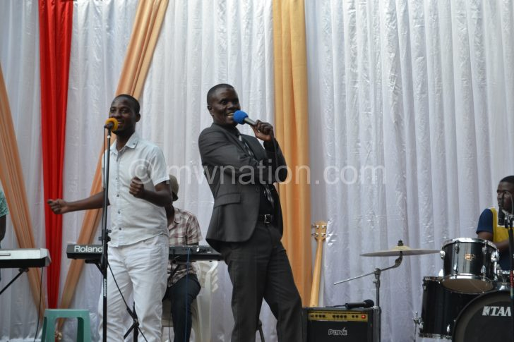 Ngumuya (R) performing during the event