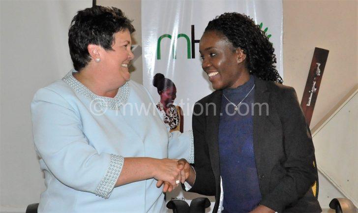 Palmer (L) congratulates Sibande