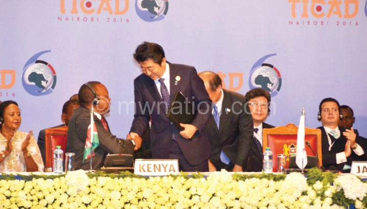 Abe interacts with Kenyan President Uhuru Kenyatta and representatives of firms from Africa