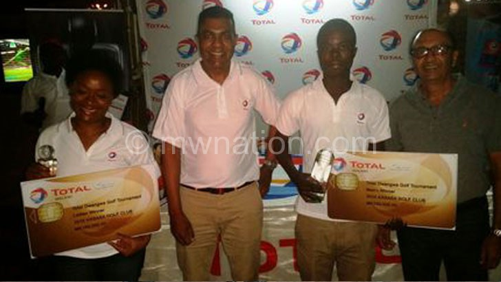 Chisale (2ndR) and Chakaniza (L) in ecstatic mood after receiving trophies from Kistasamy (2ndL) and Illovo Dwangwa Estate general manager Lal Bachan