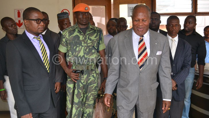 Muluzi walks out of the court premises during a previous hearing