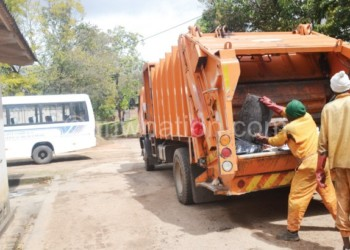 Council workers collecting refuse, one of the services councils  are expected to provide