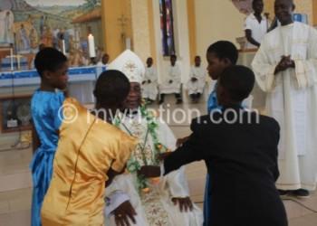 Children wish the bishop a Happy New Year