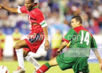 Former Flames captain John Maduka (L) in action  against Morocco in 2005