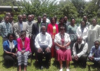 Rev. Fr. Kuziona (centre) poses  with participants