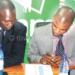 Sulom treasurer Tiya Somba-Banda (L) and TNM's Daniel Makata at 2016 season sponsorship announcement