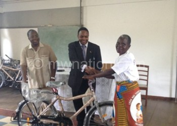 One of the educators receiving  a bicycle