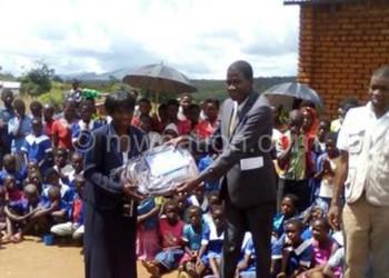 Namani (R) making a symbolic donation of the items to Chunga