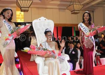 Moment of glory: Cecilia (C) with her first and second princess after being crowned the new Miss Malawi