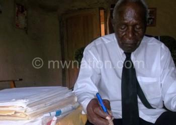 Mhango writing the book