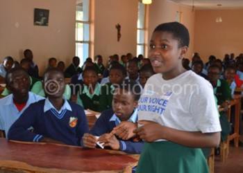 St Mary's Hellen Kapire shares her opinion during the meeting