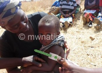 A child being tested for malnutrition