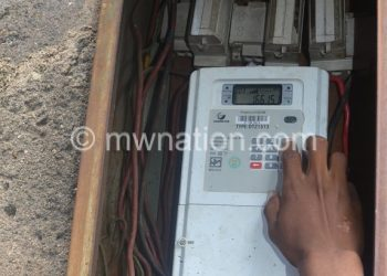 A consumer loading prepaid electricity credit whose  tariffs have been revised