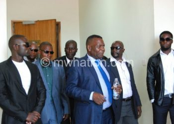 Flashback: Chaponda gets out of court surrounded by his bodyguards