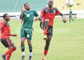Chirwa (R) challenges a Lesotho player during the match