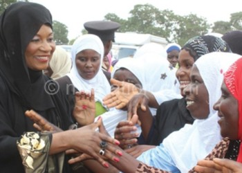 Mutharika (L) interacts with some of the women after  the opening of the Ijtmah