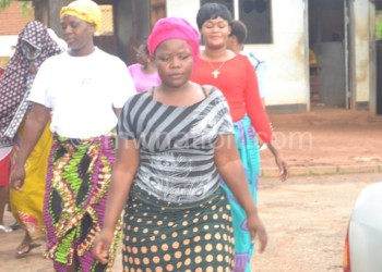 Chinguwo (in front),  Banda (in red) and Chatsika going into the court room