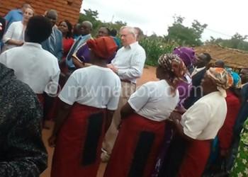 Community members interact with the Duke (C) and Tett